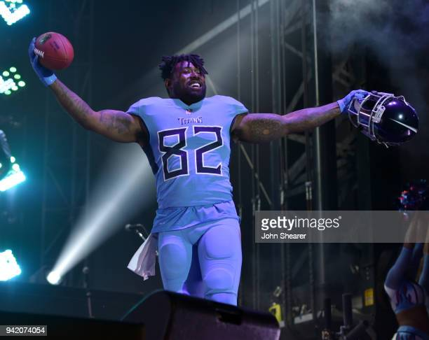 Tennessee Titan Delanie Walker shows off new uniform during The NFL's Tennessee Titans team up for the 'Tradition Evolved' concert event in downtown...