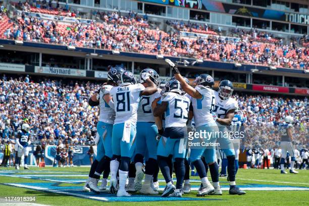 Tennessee Titans celebrate a touchdown scored by David Quessenberry during the second quarter against the Indianapolis Colts at Nissan Stadium on...
