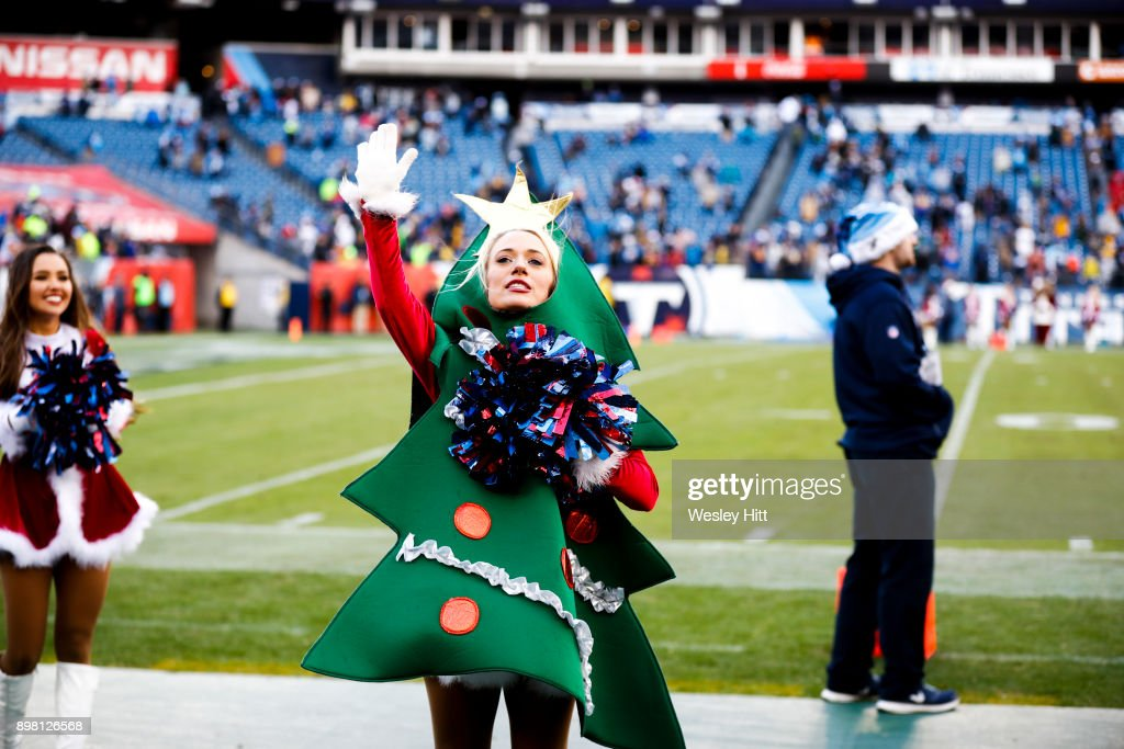 A Tennessee Titans cheerleader dances on the sideline during a game against the Los Angeles Rams at Nissan Stadium on December 24, 2017 in Nashville, Tennessee.