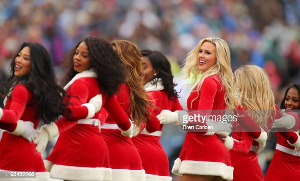 Tennessee Titans cheerleaders in Santa Claus outfits during the second half against the New Orleans Saints in the game at Nissan Stadium on December...