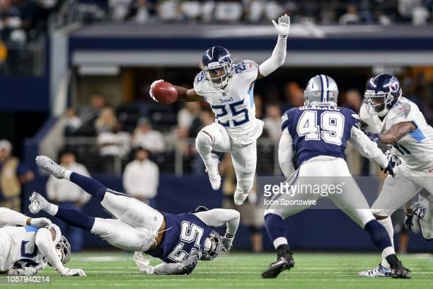Tennessee Titans cornerback Adoree' Jackson leaps over Dallas Cowboys linebacker Justin MarchLillard during a kick return in the game between the...