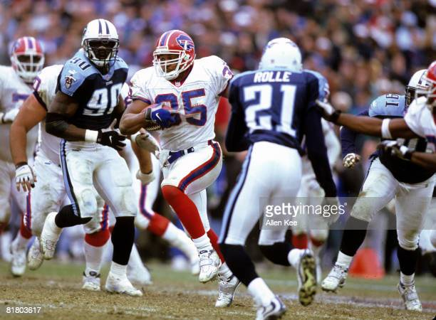 Tennessee Titans cornerback Samari Rolle and defensive end Jevon Kearse close in on Buffalo Bills fullback Jonathan Linton during the AFC Wildcard...