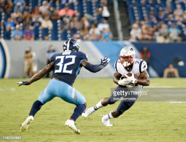 Tennessee Titans defender David Fluellen tries to tackle New England Patriots running back Damien Harris during a preseason game between the...