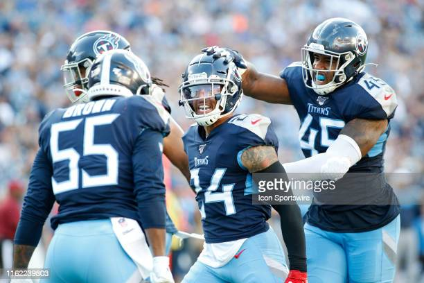 Tennessee Titans defender Kenny Vaccaro celebrates a sack with teammates during a preseason game between the Tennessee Titans and New England...