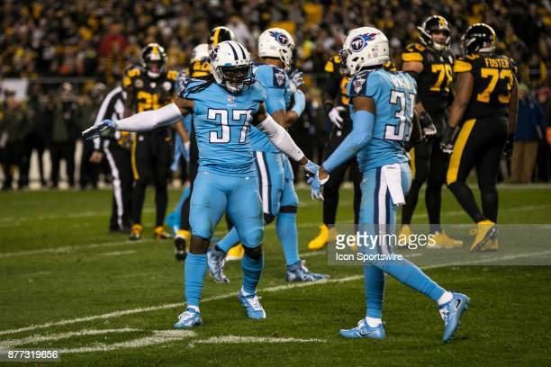 Tennessee Titans Defensive Back Jonathan Cyprien shakes hands with Tennessee Titans Defensive Back Kevin Byard during the game between the Tennessee...