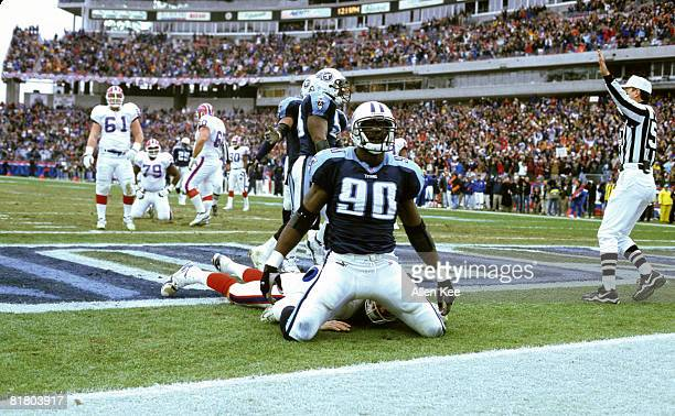 Tennessee Titans defensive end Jevon Kearse sacks Buffalo Bills quarterback Rob Johnson during the AFC Wildcard Playoff a 2216 Titans victory on...