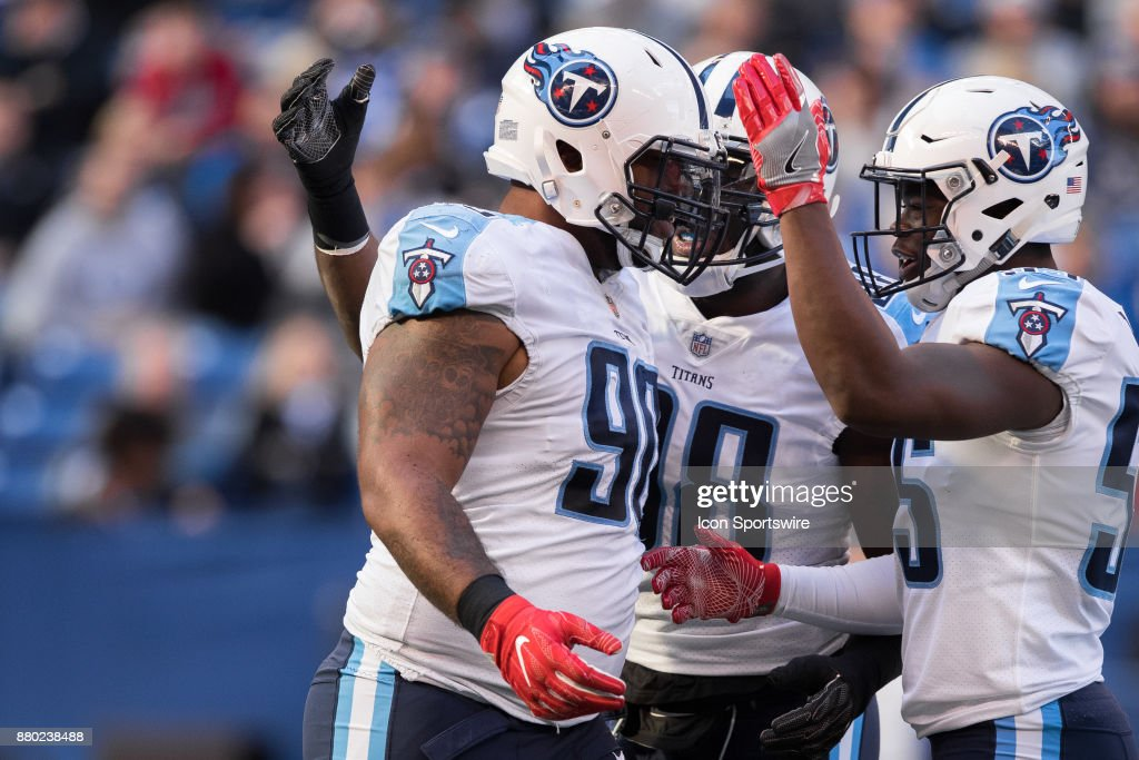 Tennessee Titans defensive lineman DaQuan Jones (90) celebrates a sack with Tennessee Titans linebacker Jayon Brown (55) during the NFL game between the Tennessee Titans and Indianapolis Colts on November 26, 2017, at Lucas Oil Stadium in Indianapolis, IN.