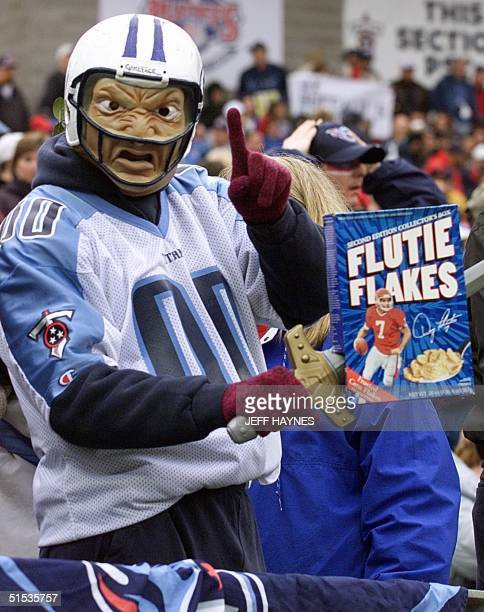 Tennessee Titans fans Don Bernitt holds a box of Flutie Flakes cereal before the game against Buffalo Bills in the AFC Wild Card Game 08 January 2000...