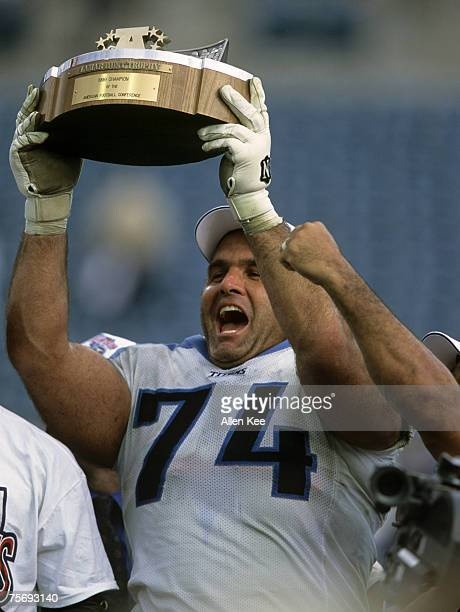 Tennessee Titans guard Bruce Matthews holds up the Lamar Hunt Trophy following the Titans 3314 victory over the Jacksonville Jaguars in the 1999 AFC...