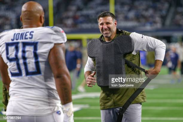 Tennessee Titans head coach Mike Vrabel puts on padding to work with defensive end DaQuan Jones prior to the game between the Tennessee Titans and...