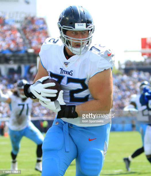 Tennessee Titans offensive tackle David Quessenberry catches a touchdown in the first half during a game between the Tennessee Titans and...