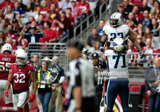 Tennessee Titans offensive tackle Dennis Kelly hoists up running back Derrick Henry after a touchdown during the NFL football game between the...