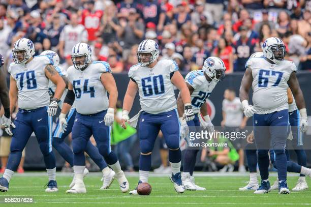 Tennessee Titans offensive tackle Jack Conklin offensive guard Josh Kline center Ben Jones and offensive guard Quinton Spain walk up to the line of...