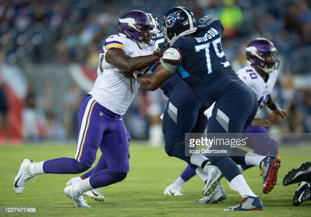 Tennessee Titans offensive tackle Laurence Gibson blocking Minnesota Vikings defensive end Stephen Weatherly during a game between the Tennessee...
