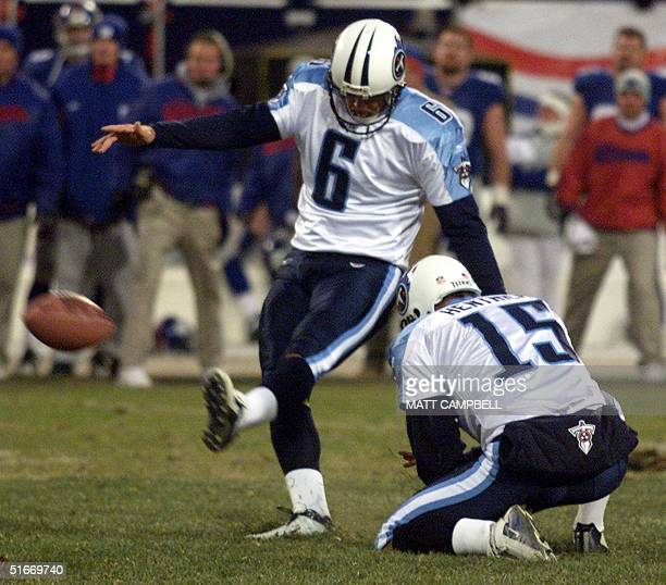 Tennessee Titans' placekicker Joe Nedney kicks the gamewinning field goal in overtime as Craig Hentrich holds for a 3229 victory over the New York...