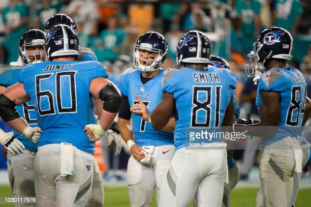 Tennessee Titans Quarterback Blaine Gabbert calls a play in the huddle with Tennessee Titans Center Ben Jones Tennessee Titans Tight End Jonnu Smith...