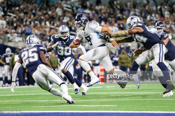 Tennessee Titans quarterback Marcus Mariota breaks free for a touchdown rush during the game between the Tennessee Titans and Dallas Cowboys on...