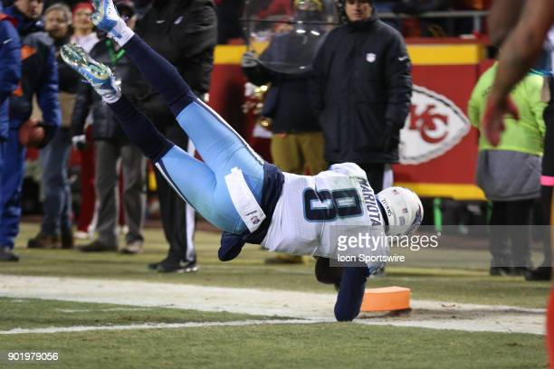 Tennessee Titans quarterback Marcus Mariota dives for the end zone after catching his own deflected pass for a 6yard touchdown reception with 644...