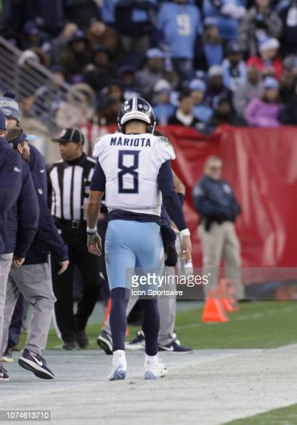 Tennessee Titans Quarterback Marcus Mariota goes to the locker room after suffering an injury at the end of the first half of a game between the...