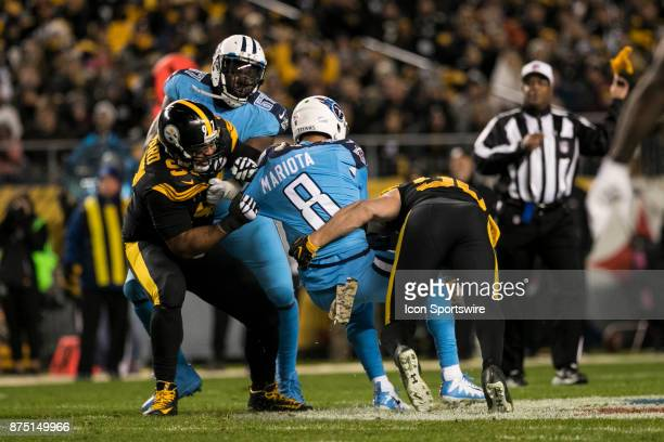 Tennessee Titans Quarterback Marcus Mariota is brought down hard by Pittsburgh Steelers Defensive End Cameron Hayward and Pittsburgh Steelers...