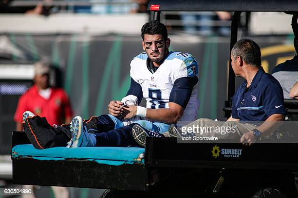 Tennessee Titans Quarterback Marcus Mariota is carted off the field after an injury during the NFL game between the Tennessee Titans and the...