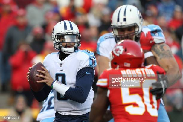 Tennessee Titans quarterback Marcus Mariota looks to pass while offensive tackle Jack Conklin tries to hold off Kansas City Chiefs outside linebacker...