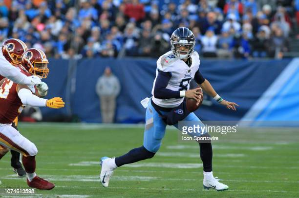 Tennessee Titans Quarterback Marcus Mariota scrambles out of the pocket in the first half of a game between the Tennessee Titans and Washington...