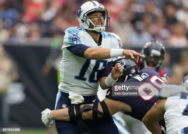 Tennessee Titans quarterback Matt Cassel throws the ball before getting tackled by Houston Texans defensive end JJ Watt during the NFL game between...