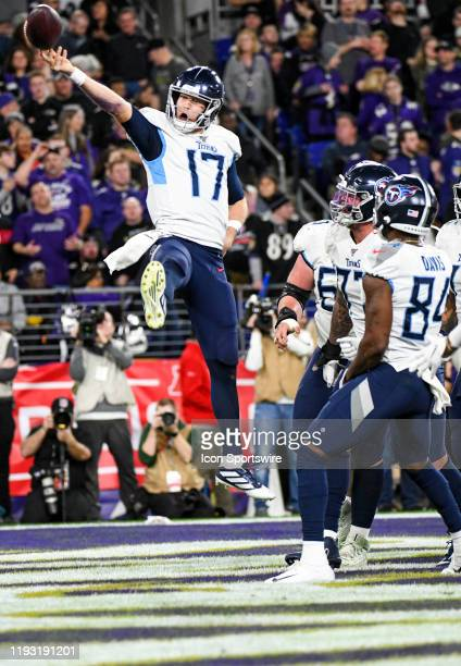 Tennessee Titans quarterback Ryan Tannehill celebrates after running for a one yard touchdown in the third quarter against the Baltimore Ravens in...