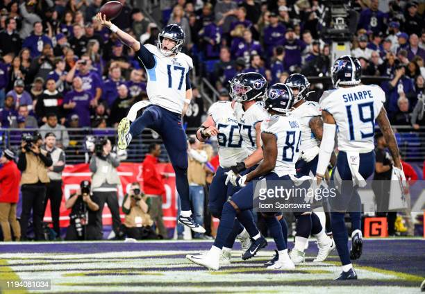 Tennessee Titans quarterback Ryan Tannehill celebrates after running for a one yard touchdown in the third quarter against the Baltimore Ravens on...