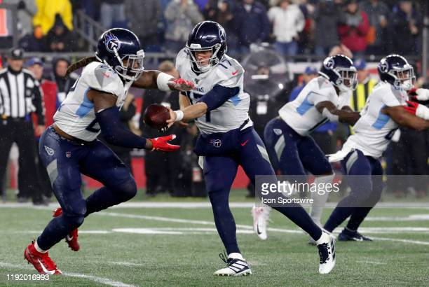 Tennessee Titans quarterback Ryan Tannehill gives the ball to Tennessee Titans running back Derrick Henry during an AFC Wild Card game between the...