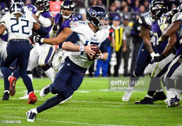 Tennessee Titans quarterback Ryan Tannehill scrambles out of the pocket against the Baltimore Ravens on January 11 at MT Bank Stadium in Baltimore MD...