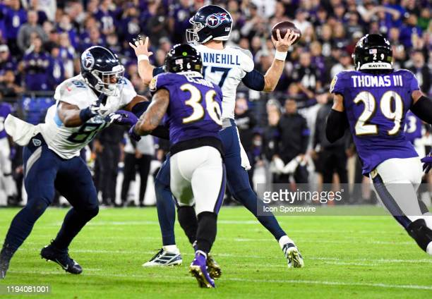 Tennessee Titans quarterback Ryan Tannehill throws under pressure by Baltimore Ravens strong safety Chuck Clark on January 11 at MT Bank Stadium in...