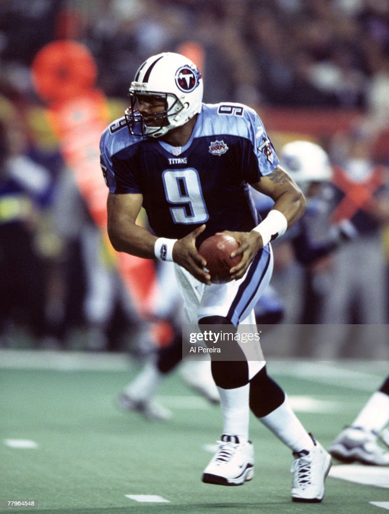 Tennessee Titans quarterback Steve McNair (9) hands off running during Super Bowl XXXIV, a 23-16 St. Louis Rams victory over the Tennesee Titans on January 30, 2000 , at the Georgia Dome in Atlanta, Georgia.