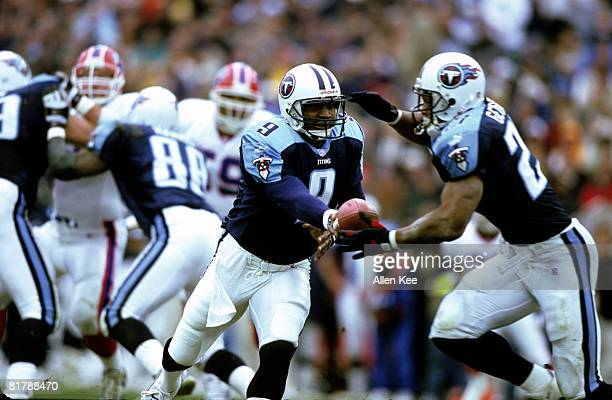 Tennessee Titans quarterback Steve McNair hands off to running back Rodney Thomas during the AFC Wildcard Playoff a 2216 victory over the Buffalo...