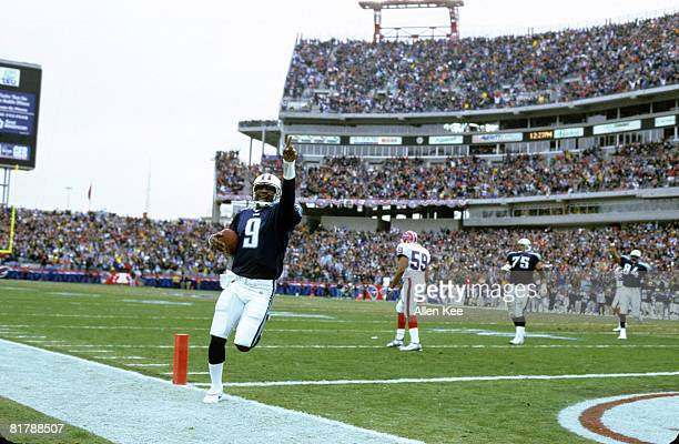 Tennessee Titans quarterback Steve McNair scores on a oneyard touchdown run during the AFC Wildcard Playoff a 2216 victory over the Buffalo Bills on...