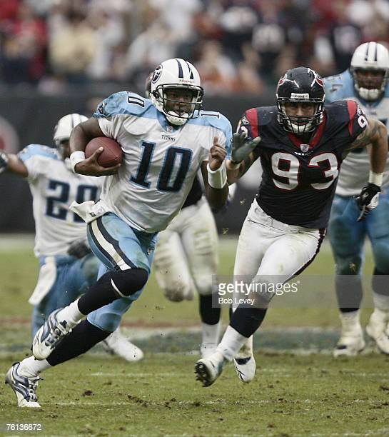 Tennessee Titans quarterback Vince Young rushes past Houston Texans defensive end Jason Babin on this 39 yard touchdown run in overtime during the...