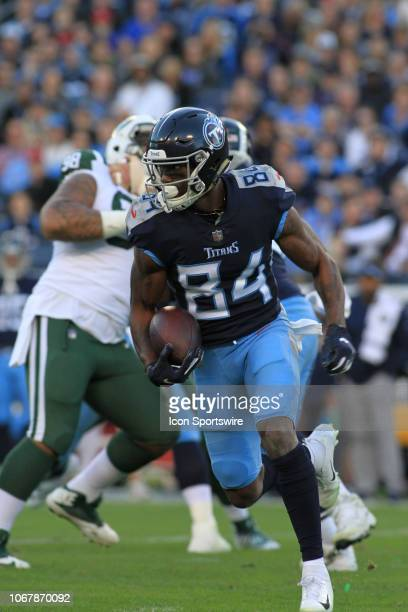 Tennessee Titans receiver Corey Davis catches a pass in the first half of a game between the Tennessee Titans and New York Jets December 2 2018 at...