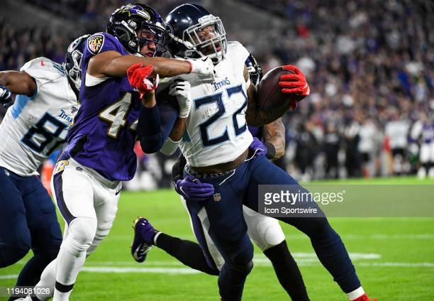 Tennessee Titans running back Derrick Henry avoids a tackle attempt by Baltimore Ravens cornerback Marlon Humphrey on January 11 at MT Bank Stadium...