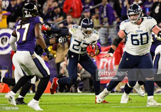 Tennessee Titans running back Derrick Henry avoids a tackle by the Baltimore Ravens on January 11 at M&T Bank Stadium in Baltimore, MD. In the AFC...