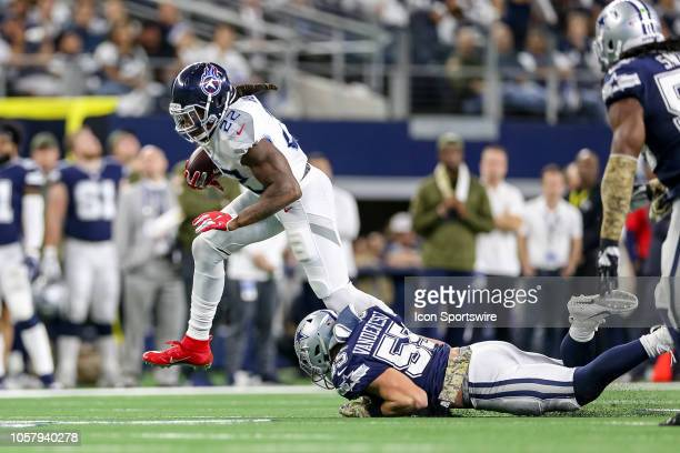 Tennessee Titans running back Derrick Henry breaks free of a tackle attempt by Dallas Cowboys outside linebacker Leighton Vander Esch during the game...