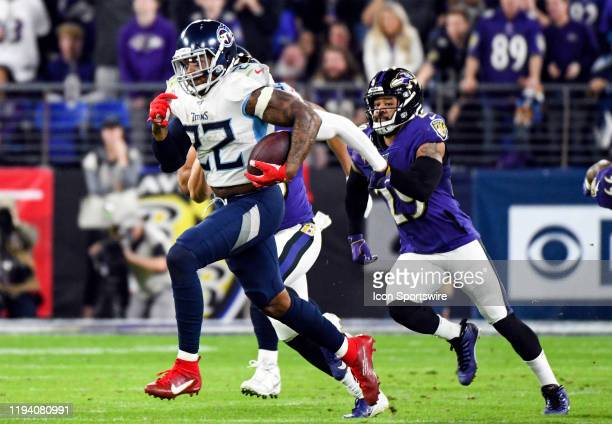 Tennessee Titans running back Derrick Henry breaks off a long run against Baltimore Ravens free safety Earl Thomas III on January 11 at MT Bank...