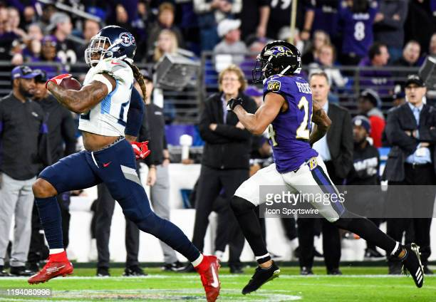 Tennessee Titans running back Derrick Henry breaks off a long run against Baltimore Ravens cornerback Marcus Peters on January 11 at MT Bank Stadium...