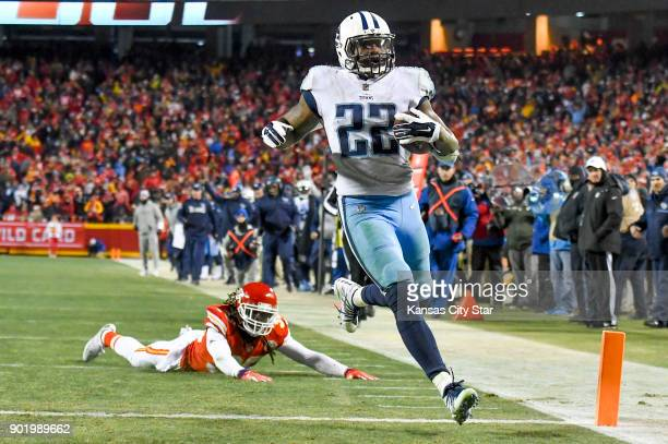 Tennessee Titans running back Derrick Henry crosses the goal line as a diving Kansas City Chiefs free safety Ron Parker watches Henry score a 35yard...