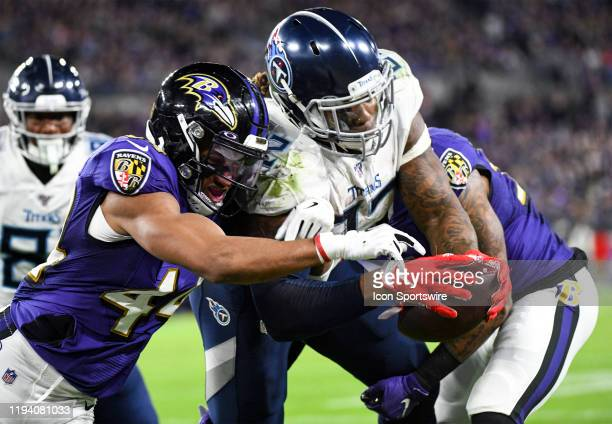 Tennessee Titans running back Derrick Henry dives for the end zone against Baltimore Ravens cornerback Marlon Humphrey on January 11 at MT Bank...