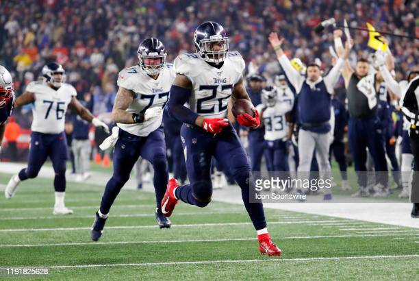 Tennessee Titans running back Derrick Henry heads for the end zone during an AFC Wild Card game between the New England Patriots and the Tennessee...