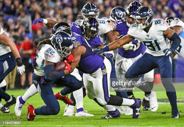 Tennessee Titans running back Derrick Henry is brought down by Baltimore Ravens defensive end Brandon Williams on January 11 at MT Bank Stadium in...