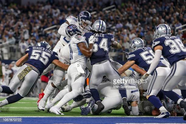 Tennessee Titans running back Derrick Henry leaps over the pile for a rushing touchdown during the game between the Tennessee Titans and Dallas...