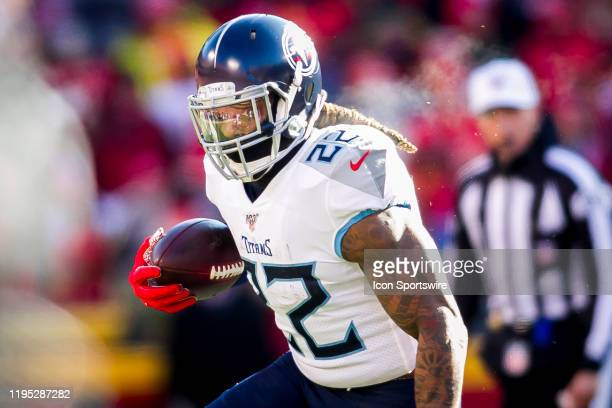 Tennessee Titans running back Derrick Henry looks carries the ball during the AFC Championship game between the Tennessee Titans and the Kansas City...