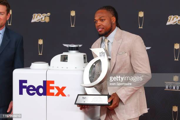 Tennessee Titans running back Derrick Henry receives the FEDEX ground player of the year poses on the Red Carpet poses prior to the NFL Honors on...